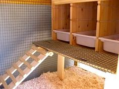 Pull-out next boxes - easy to dump and spray clean with the hose.