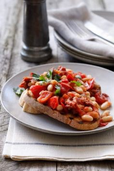White beans with spicy chipotle tomatoes on toast.