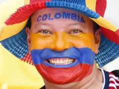 Longest period between World Cup appearances: 16 Years, Columbia 1998-2014 | In pic: A fan of Columbia smiles before the quarter-final football match between Brazil and Colombia at the Castelao Stadium in Fortaleza during the 2014 FIFA World Cup on July 4, 2014.  | www.dribblingman.com