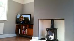 Grey lounge with esse 500 wood burner, dulux chic shadow and urban obsession, kaindl one floor in barn oak, retro teak furniture Dulux Chic Shadow, New Living Room, Living Room Decor, Wall Colors, Paint Colours, Grey Lounge, Grey Houses, Grey Room, Teak Furniture