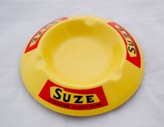Vintage French SUZE Liqueur Advertising Ashtray Yellow Ceramic by Triggerstreasure on Etsy Vintage Bar, French Vintage, Advertising Logo, Pin Box, Slide Rule, Vintage Advertisements, Hand Carved, Plates, Ceramics