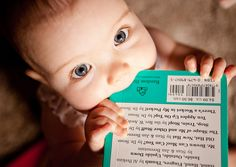"Gorgeous baby ""devouring"" a book via Flickr"