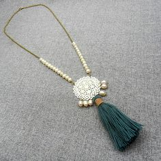 Unique pearl tassel necklace with an intricate hand carved bone pendant and genuine fresh water pearls on a rustic pure brass chain. This tassel necklace is an elegant mix of boho and Victorian styles, a unique feminine twist on a traditional mala necklace. The focal unit of this