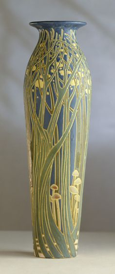 "Frederick Hurten Rhead (1880-1942) - For University City Pottery - Vase. Incised, Painted and Glazed Pottery. University City, Missouri. Circa 1911. 17-1/4"" x 5-1/8""."
