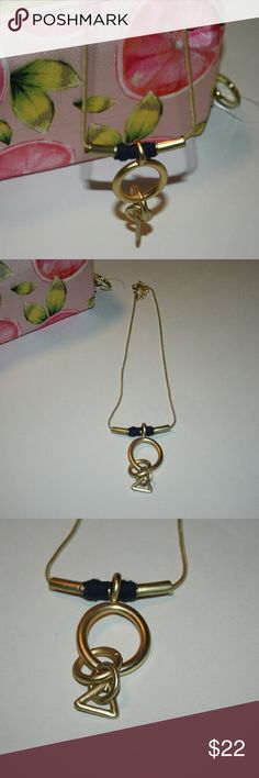 """▪Matte Gold tone with blue ribbon Short Necklace▪ Brand new without tags.  Gold tone is not shiny and has a blue ribbon.   Measures 10.5"""" length with a 3"""" extension.   Sorry no trades. If you have any questions please ask. If you don't like the price please use the offer button.  Happy Poshing! """"Great Sense of Style"""" Boutique  Jewelry Necklaces"""