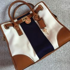 "Michael Kors North South LARGE Hamilton Bag Tote LOVE LOVE LOVE  this Kors Handbag! Original retail $398+ tax! Includes the MK plastic Wrap and satin feel dust bag! Michael Michael Kors Hamilton North South Canvas Leather Tote NEW without tags. Canvas & Leather exterior. Color: Beige|Blue|Brown Hardware: Gold-Tone Measurements (L x W x H): 14.25 x 4.25 x 13.5 Strap Drop: 12"" Handle Drop: 4.5"" Exterior Pockets: 0 Interior Pockets: 5 Interior Lining: MK logo Canvas KORS Michael Kors Bags Totes"