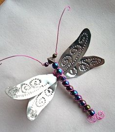 Punched tin, beads, and wiring make this beautiful dragonfly ornament.
