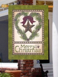 """ Christmas Barn Star "" - Merry Christmas - Large Size 28 Inch X 40 Inch Decorative Flag by Custom Decor. $18.99. Flag has opening at top that fits on standard flagpoles. Size: 28"" x 40"". Material: 100% durable polyester, fade resistant, permanent-dyed. Design: There is a green border around the flag. There then is a red border, a green and white striped border, and another red border. Near the bottom of the flag is ""Merry Christmas"" message. Above the message is a heart shape..."
