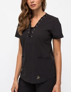 This casual fit top features a lace-up design along the neckline, detailed with our signature gold eyelet trims for an edgy accent. #scrubs #uniform