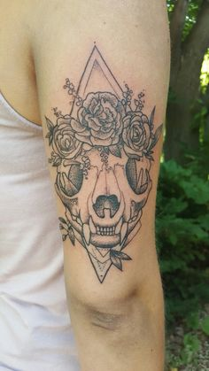 Cat skull rocking a flower crown. Done by Alex Gregory from Evolution Tattoo Minnesota!!