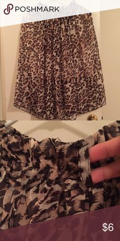 Leopard print skirt Leopard print flowy skirt. With belt loop so you can use what ever belt of your choice. Excellent condition and very pretty. Just need to clear out my closet. No specified size but stretchable so will fit sizes small/medium Skirts Midi