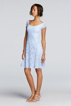 Looking for aversatile bridesmaid dress? Consider this illusion dress with capsleeves!  Lace illusion cap sleeves paired with scoop back.  Skirt lengthsitsabove the knee with scalloped hemline.  Also available in extra length sizes as Style 2XLF19095. Fully lined. Zipper Back. Imported polyester. Dry clean only.