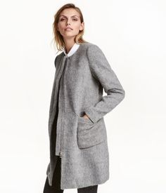 Gray melange. Collarless coat in thick wool-blend fabric with a brushed finish. Concealed zip with wind flap and patch front pockets with flap. Lined.