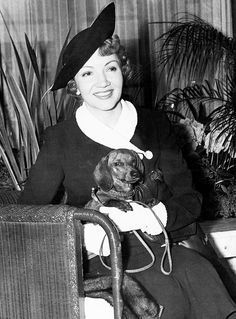 Claudette Colbert with dachshund
