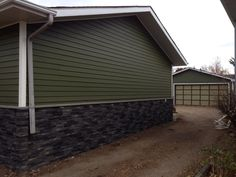 Hardie board siding with rock underneath. House and garage match