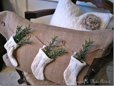 Use a cheap sweater from a thrift store to make stockings, then fill with plant