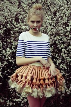 Girl Wears Skirt Made of Barbie Dolls. what the hell? so weird....