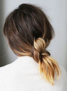 The only time we're okay with our hair being knotted, this style is chic, simple, and totally rainproof. Watch this knotted ponytail tutorialto learn how to do it yourself inone...