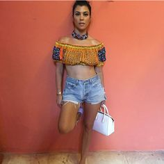 Rock a pattern crop top with high-waisted shorts for a look as hot as Kourtney Kardashian.