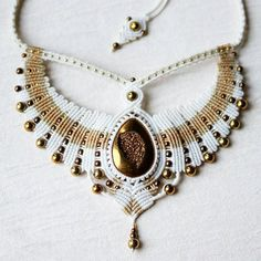 Necklace with titanium agate #macrame #micromacrame #svitoe #handmade #necklace #beauty #boho #bohemian #jewelry #bijoux #custom #white #golden #beige #natural #stone #agate #titaniumagate #hematite #wings #bird
