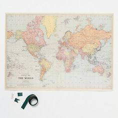 Plan future trips or record memorable journeys with this creative kit, containing all a traveler needs to make custom ribbon flags that mark favorite locales on a reprinted, vintage world map.