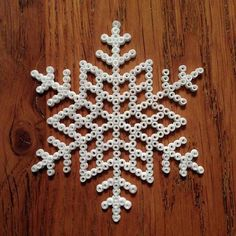 Snowflake perler beads by hellesolstraale Easy Perler Bead Patterns, Fuse Bead Patterns, Beading Patterns, Pearler Beads, Fuse Beads, Christmas Afghan, Snow Crafts, Snowflake Craft, Iron Beads