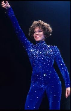Whitney wearing one of the hundreds of bodysuits he designed for her during her career