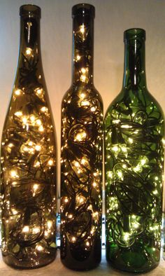 Recycled Wine Bottle Lights by OldGlassWithClass on Etsy, $16.99.. Easy DIY just drill small hole in back of bottle for cord. Saw this at a winery last weekend, it was beautiful!!