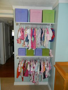 Baby's creative open closet  Creating a closet in a nursery using shelving Baby Storage, No Closet Solutions, Baby Room Decor, Nursery Room, Nursery Organization, Baby Registry, Hanging Clothes, Kid Closet, Baby Essentials