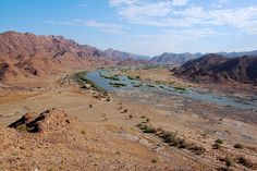 The Orange River is South Africa's longest river, part of which forms the border between South Africa and Namibia before flowing out to the Antlantic Ocean. Land Of The Brave, My Land, All About Africa, Namibia, Desert Oasis, Family Adventure, Rivers, Middle East, Lakes