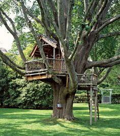 WARNING: Not your childhood treehouse. This is the perfect hideaway for children and adults...just look at that porch!!