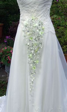Contemporary cascade white trailing dendrobium orchid wedding bouquet with crystal detail. Perfect for a bride who is looking for a unique, individually styled bridal bouquet www.blackbaccara.co.uk