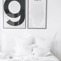 White washed bedroom spread with a touch of monochrome by...