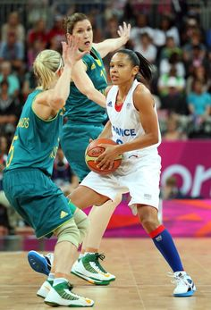 JULY 30: Edwige Lawson-Wade #8 of France controls the ball under pressure from Belinda Snell #12 and Samantha Richards #5 of Australia during the Women's Preliminary Round match on Day 3 at Basketball Arena on July 30, 2012 in London, England. (Photo by Christian Petersen/Getty Images)