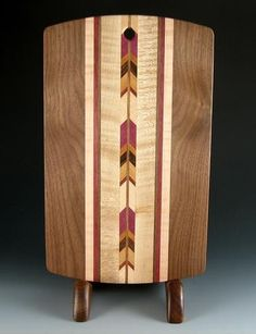 Wooden Images - Walnut Cutting Board This Cutting Board, crafted by Wooden Images is made from Walnut with inlaid exotic woods decorating the center of the board, all in their natural colors. Measurin