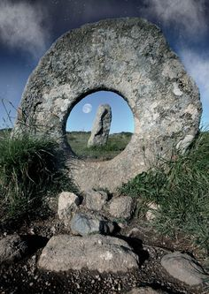 Men-an-Tol, a small formation of standing stones near the Madron-Morvah road in Cornwall, United Kingdom. Archaeologists suggest that the three stones are the remains of a Neolithic tomb.