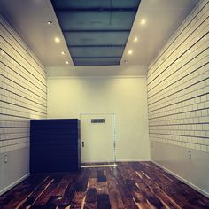 Fashion truck interior! She is incomplete in this photo but almost finished! Acacia wood flooring, subway tile slat wall, reclaimed wood cash wrap- all inside a 16 foot box truck. See you soon!