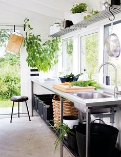 What a great multi purpose area! Potting bench,outdoor kitchen,overflow for outdoor entertaining,art studio. Concrete floors. Simple