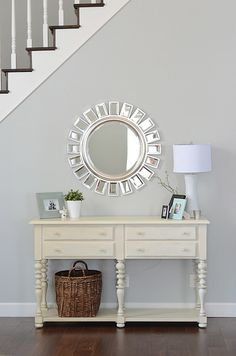 a favorite entry. great mirror, table, lamp, wall color, dark floors