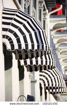 Striped awnings of a restaurant Poster Canvas Awnings, Restaurant Poster, Window Awnings, Deck Awnings, Awning Canopy, White Decor, Store Fronts, Pergola, Stripes