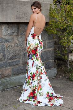 Multicolored floral prints enliven the trumpet silhouette of Jovani 24989 evening dress, edged with a scoop neckline framed by cut-in sleeves. A slim band passes across the open back, lending a sexy exit to this full-length gown that flares toward the floor with a sweep train.
