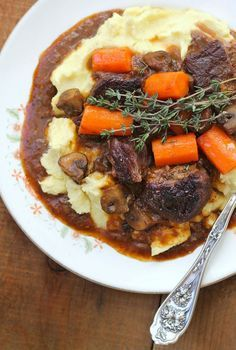 "There's something incredibly comforting about Beef and Stout Stew served on top of a velvety heap of mashed potatoes. The stout loses its strong ""beer taste"" and melds into a richly flavorful sauce."