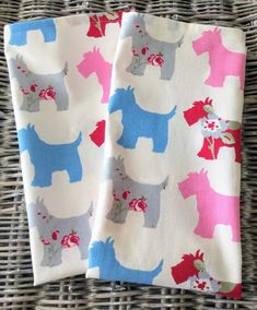 Dog print cotton tea towel in white fabric  with pink, blue red and grey dogs