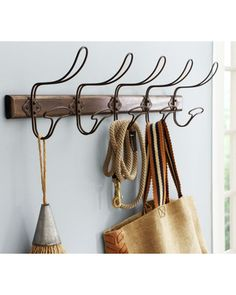 Hang your coats, purses, and everything else on these hand-twisted iron hooks. Buy it here: http://www.bhg.com/shop/pottery-barn-wire-and-wood-row-of-hooks-p505c3a0b82a71c80fdfde84b.html?socsrc=bhgpin110912shoppbcoathangers