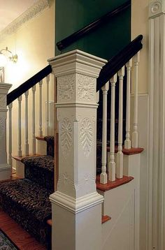 Love big, chunky, square newel posts. This one has beautiful carvings.