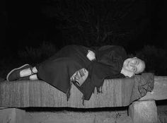Georgia O'Keeffe reclining on bench at evening campout, Ghost Ranch, New Mexico. Photo by John Candelario, ca. 1930-1940. Palace of the Governors Photo Archives 165666.