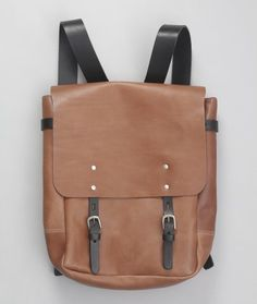 Made in London from an exceptional veg tanned leather, this stylish rucksack has thick leather bridle shoulder straps and matching front fasteners. This leather will age and soften beautifully, only getting better over time. Inside it is lined in cotton and features a zipped inside pocket for all the important stuff, as well as a zipped exterior pocket on the back.