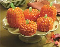 pumpkin cupcakes decorated with orange jellybeans