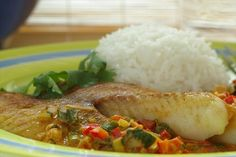 Broiled Tilapia With Thai Coconut- Curry Sauce, this is similar to my own recipe however i hold the coconut milk for shrimp dishes, i tend to find it overpowering for just plain ole talapia.