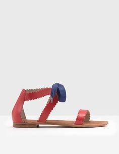 These fun shoes are an update on the classic leather sandal. The scalloping on the edges adds a special twist, and they also come with two choices of grosgrain ribbons (one stripy and one block colour) – meaning you can change up your look whenever you fancy.